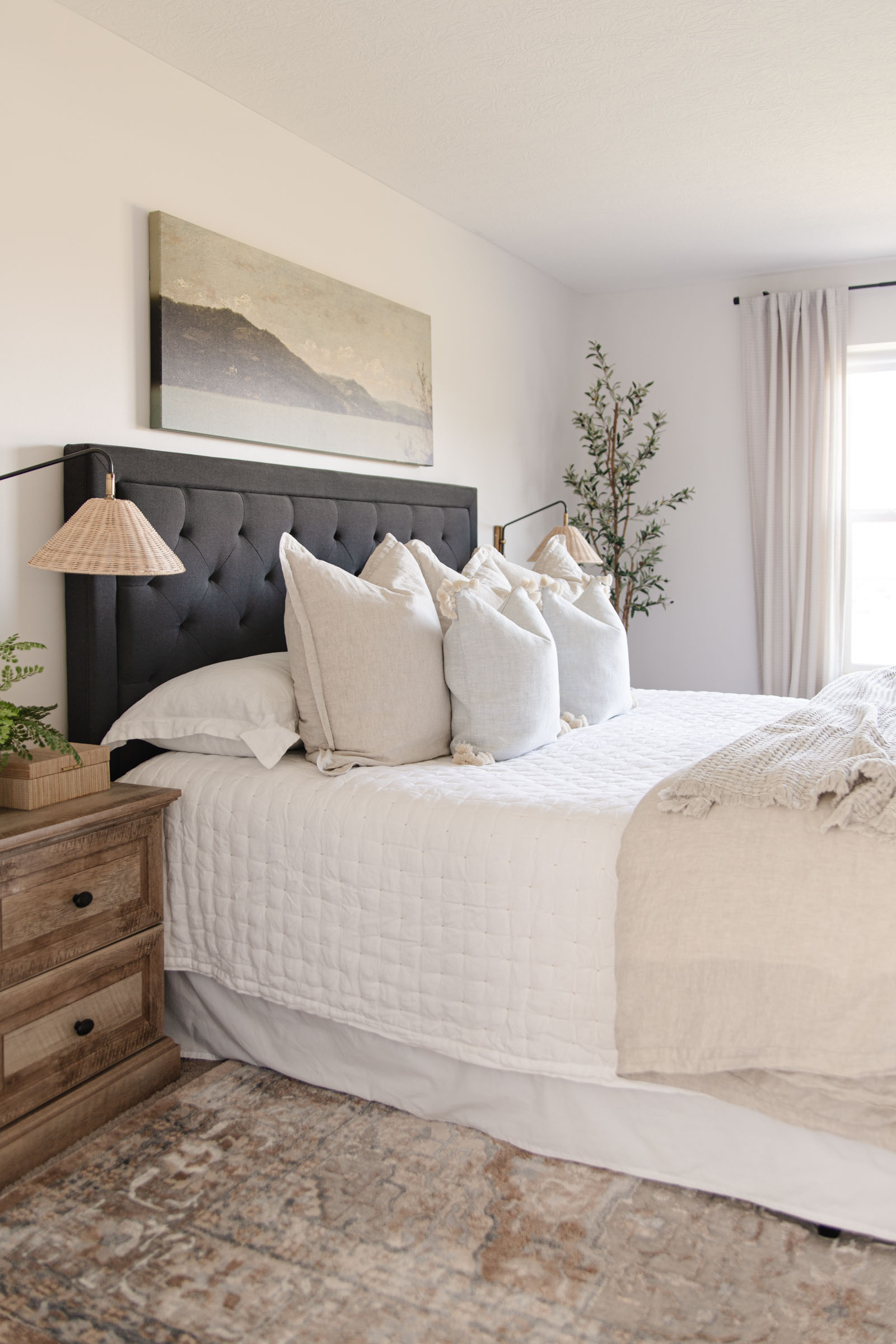 sutter linen quilt, Serena and lily bedding, beige ivied medallion rug, charcoal upholstered headboard, neutral bedroom