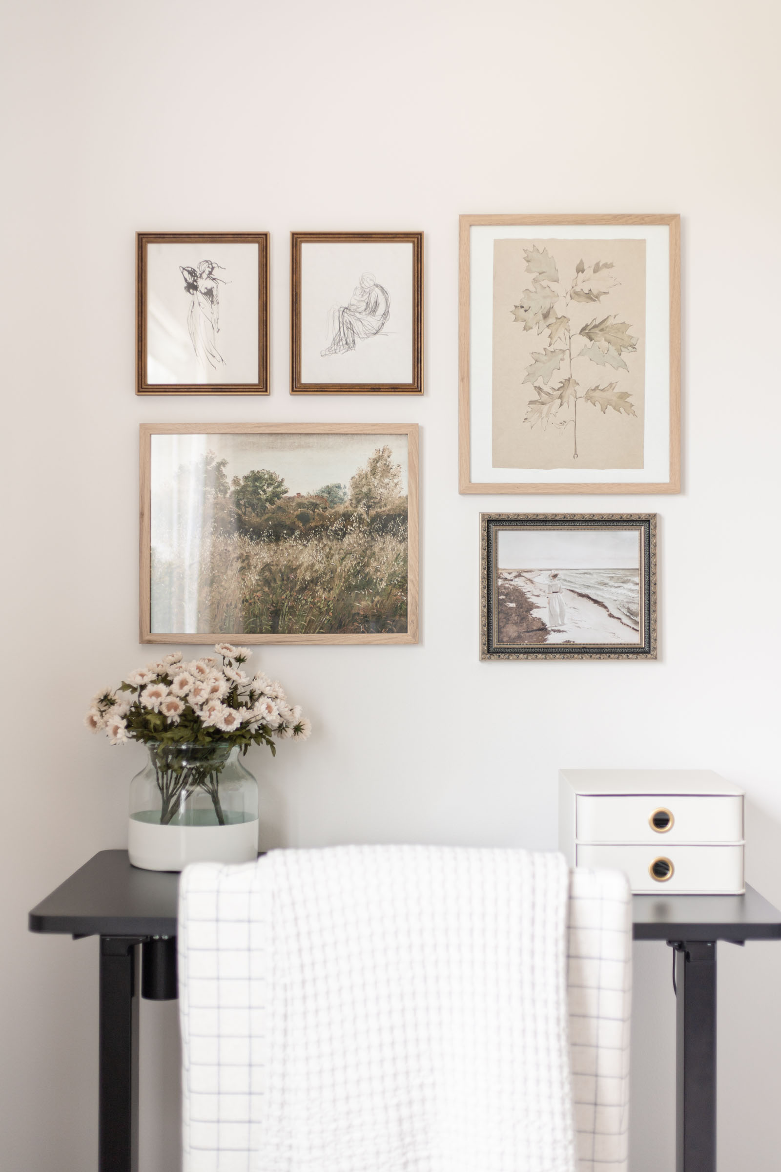 Bedroom Office Nook (and Vintage Art Gallery Wall) | black sit to stand electric standing desk, poetto vase, collected antique art gallery wall