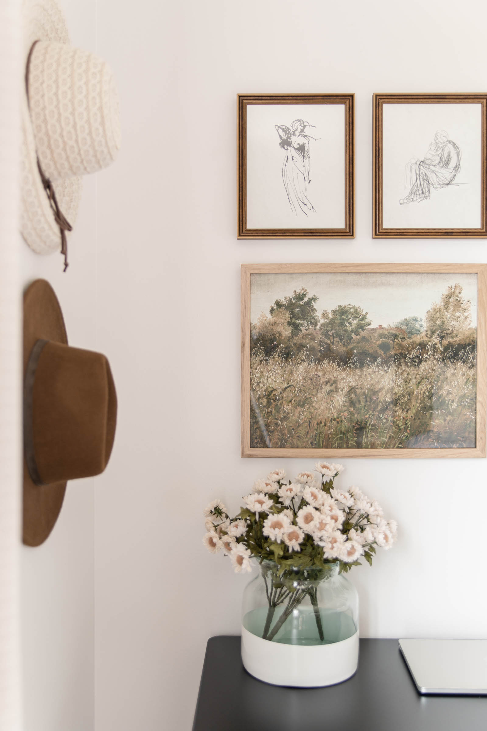 Bedroom Office Nook (and Vintage Art Gallery Wall) | small office space, hats hanging on wall, poetto vase, collected antique art gallery wall