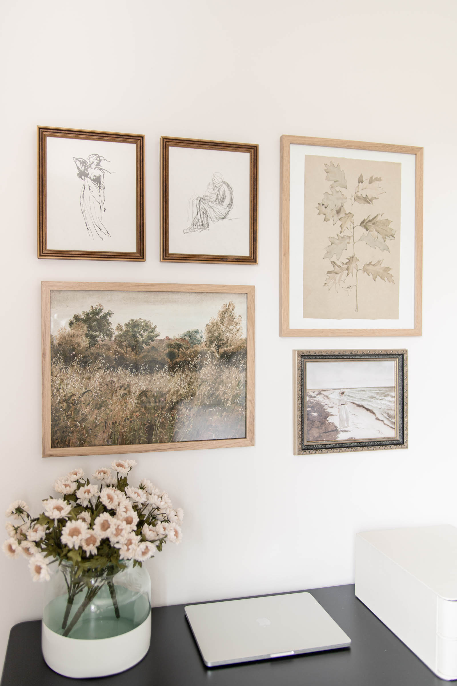 vintage art gallery wall with figure art and landscapes, poetto vase