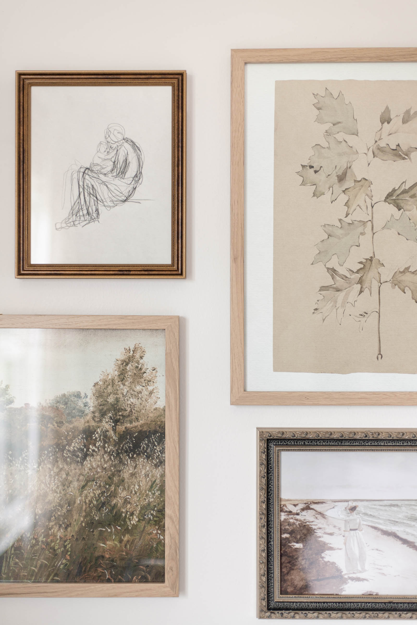 vintage art gallery wall with mismatched frames