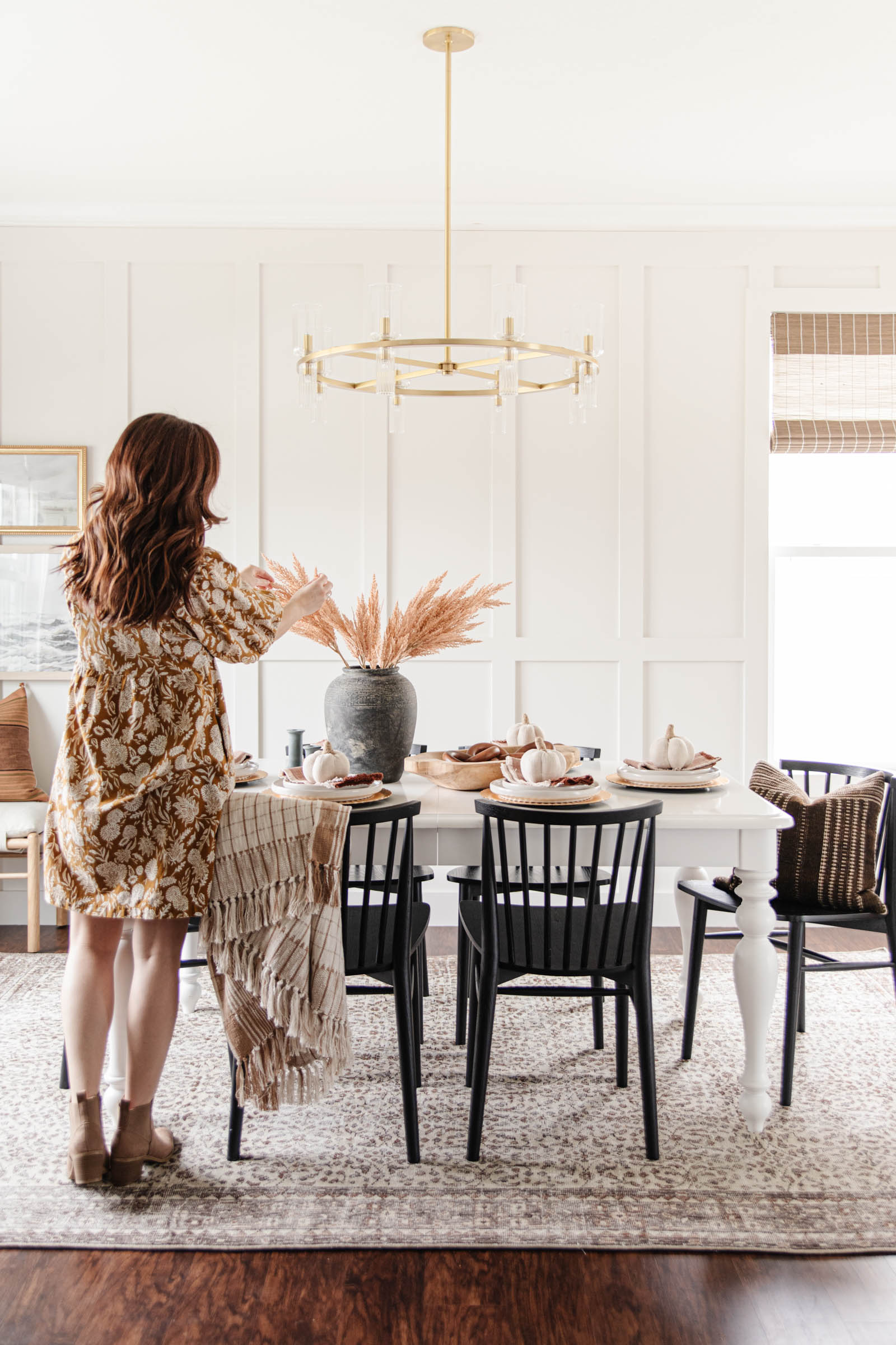 arranging faux pampas grass, fall entertaining, brown vintage rug, black dining chairs