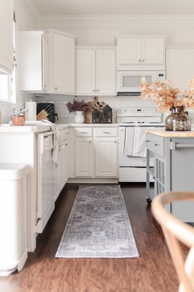 Budget Friendly Washable Rugs from Walmart | white kitchen with blue vintage look washable runner, neutral kitchen decor