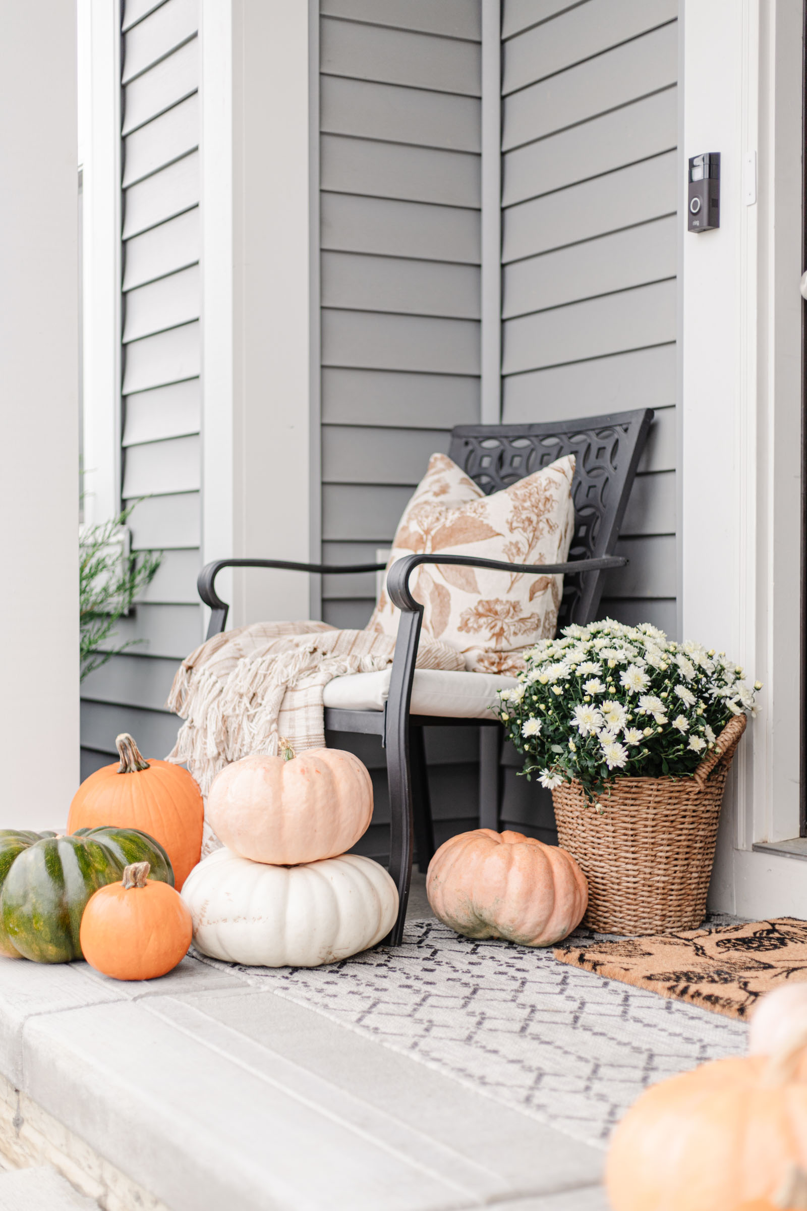 fairytale cinderella pumpkins, cozy fall porch, fall aesthetic, white mums, layered doormats, plaid throw