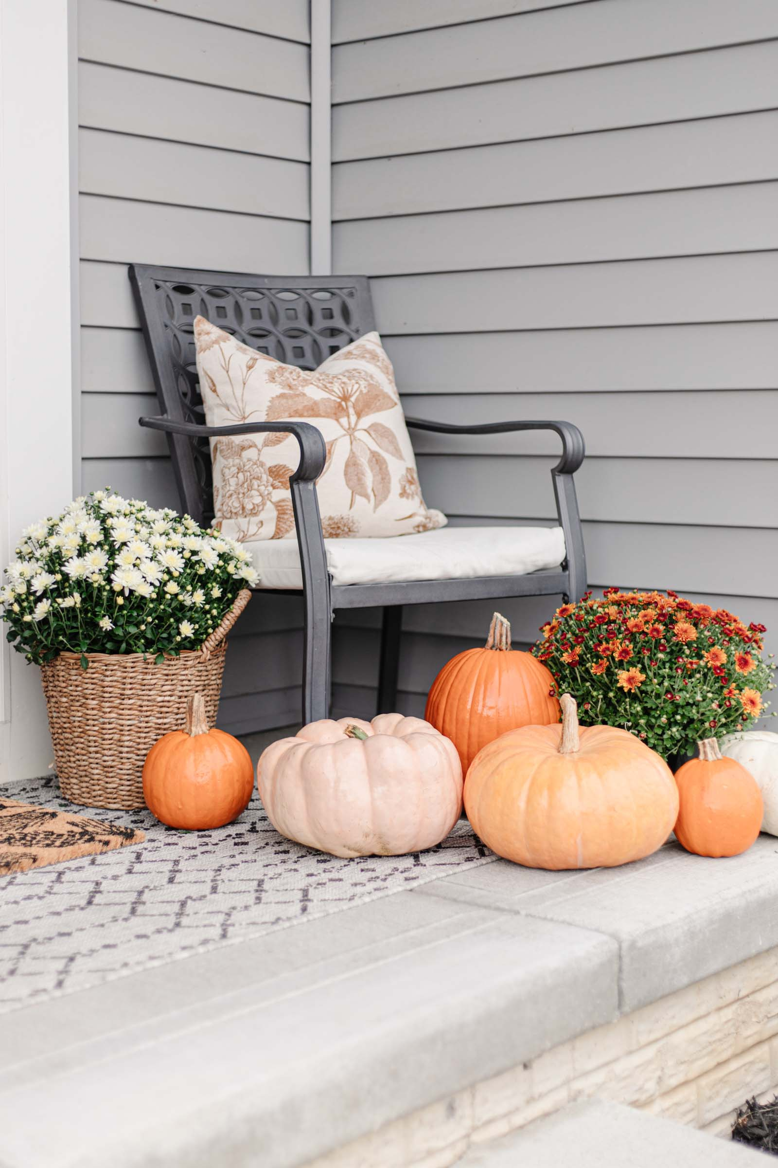 colorful pumpkins on front porch, basket planter with white mum, fall porch decor