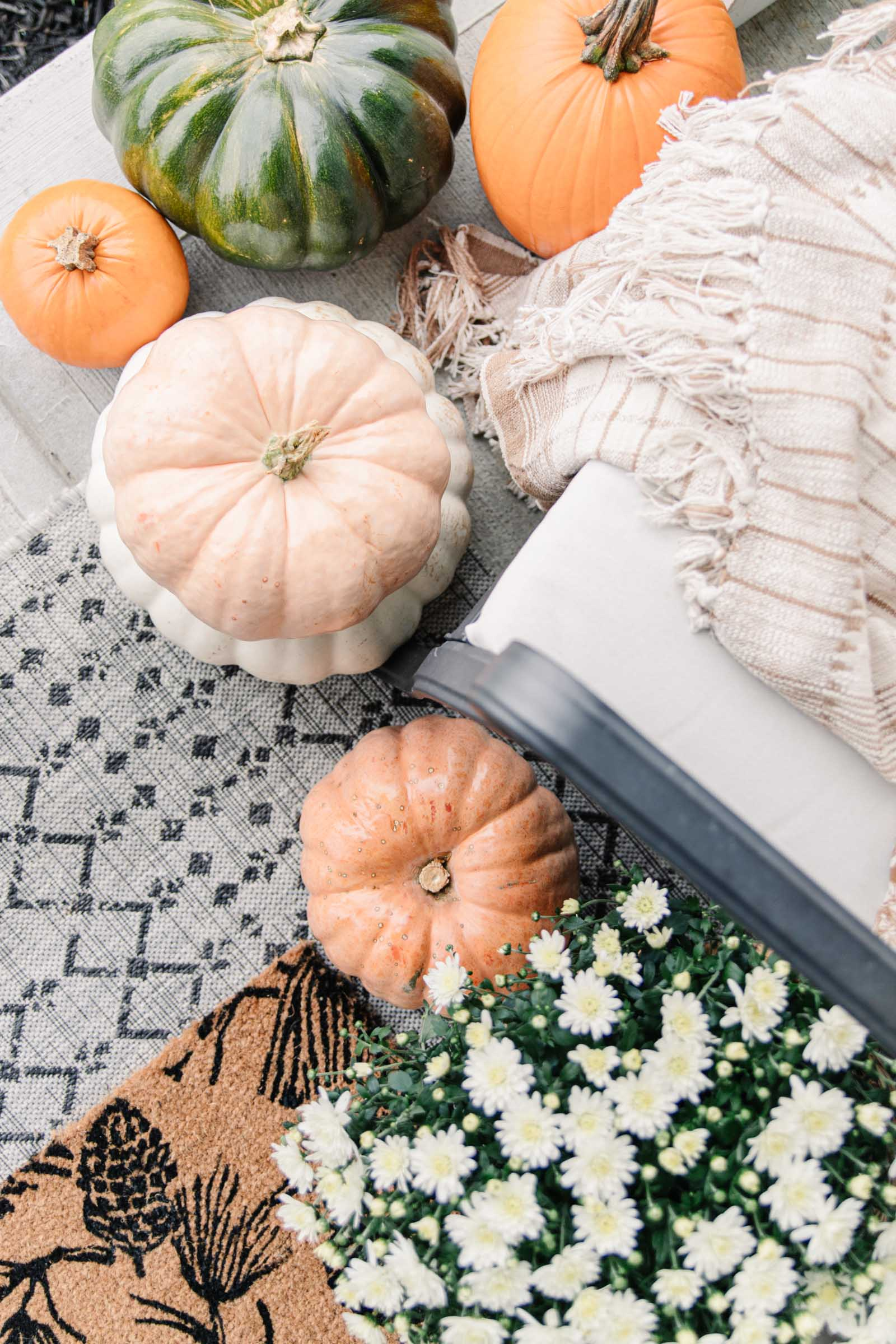 Fall Front Porch with Cinderella Pumpkins   fairytale pumpkins, cozy fall porch, fall aesthetic, white mums, layered doormats, plaid throw