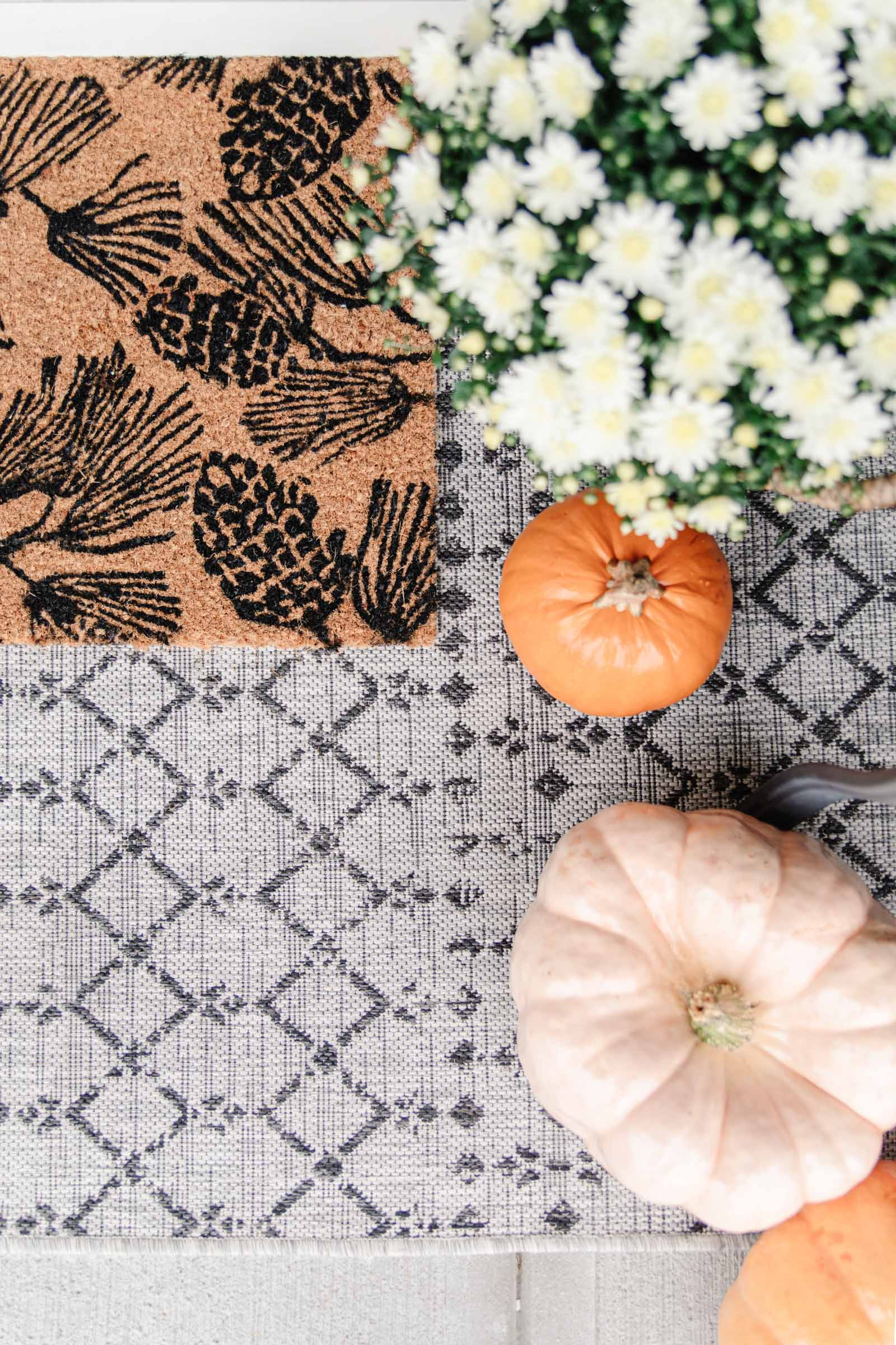layered doormats for a cozy fall front porch